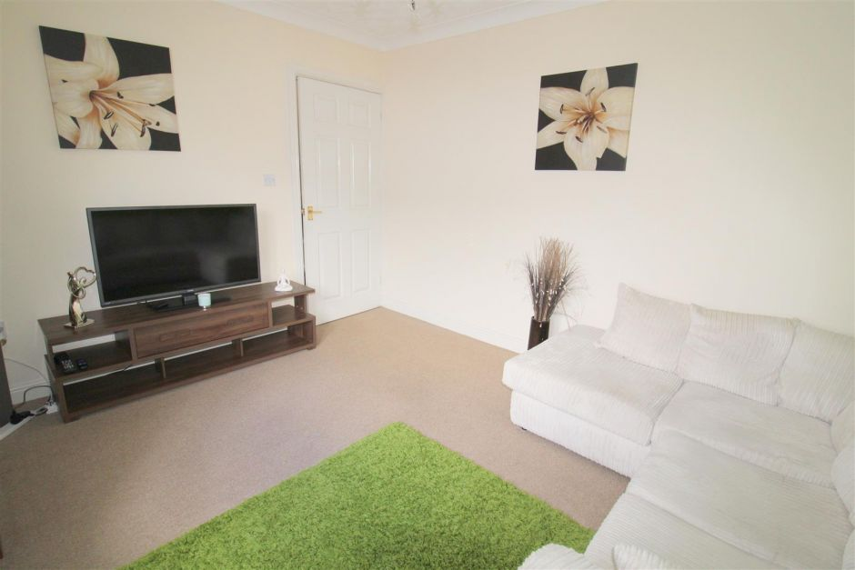 Another angle of sitting room